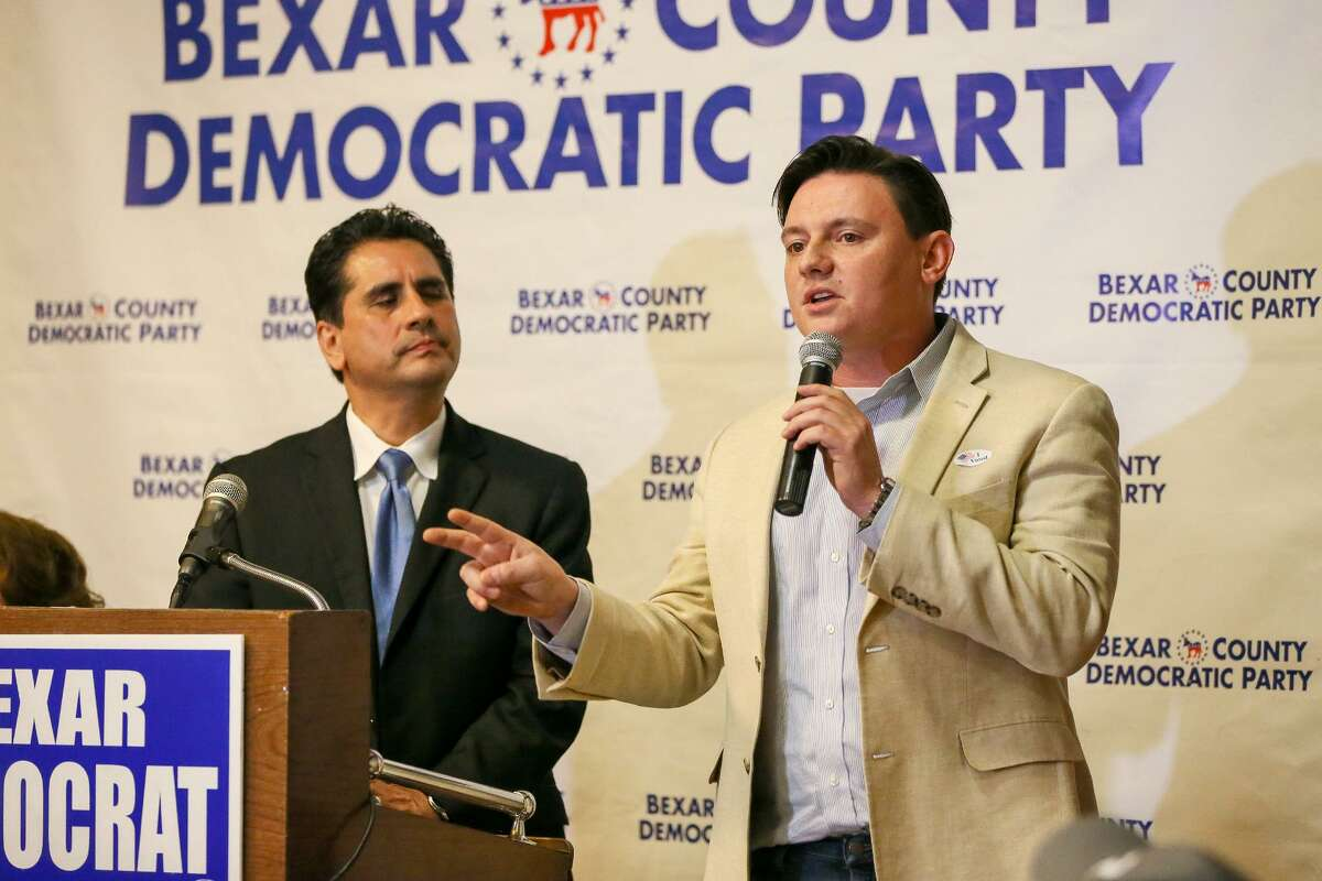 """Bexar County Democratic Party chairman Manuel Medina (left) listens as high school teacher and former City Council candidate Rick Trevino speaks during a debate between Democratic candidates running for a chance to challenge Will Hurd in U.S. District 23: Jay Hulings, Gina Ortiz Jones, Judy Canales, and Angela """"Angie"""" Villescaz at Luby's, 911 N. Main, on Tuesday, Feb. 20, 2018. MARVIN PFEIFFER/mpfeiffer@express-news.net"""