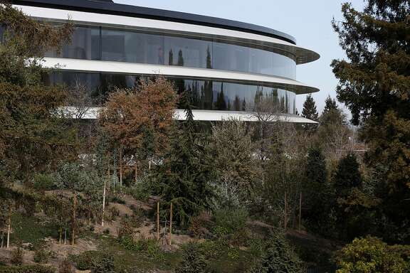 The circular Apple Park headquarters building is visible from the roof of the visitor center in Cupertino, Calif. on Tuesday, Feb. 20, 2018.