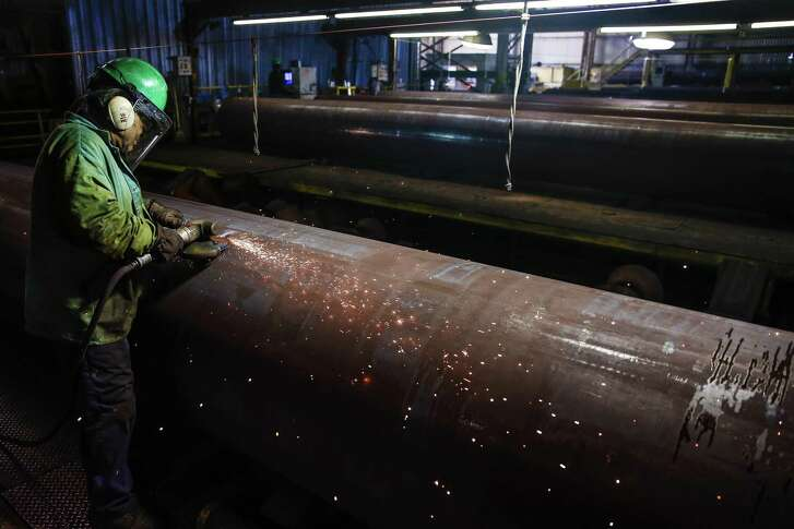 JSW Steel grinder Juan Silva smooths out part of a steel pipe Thursday, September 1, 2016 in Baytown. ( Michael Ciaglo / Houston Chronicle )