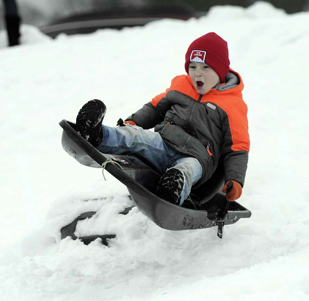 Russell Cencro, 6, of New Fairfield, sled rides down the hill at St. Gregory the Great Church in Danbury Thursday, March 8, 2018.