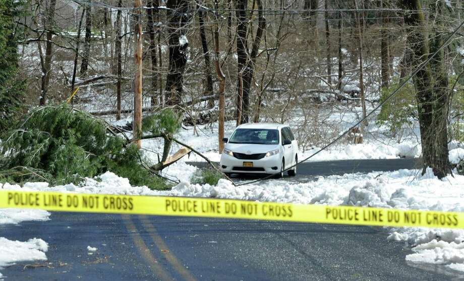 A large down limb blocks traffic from passing on Dunham Road in Fairfield, Conn. on Thursday, March 8, 2018. More than 150 roads in town were impassable as of 11 a.m.  because of downed trees and wires, police said. Photo: Cathy Zuraw / Hearst Connecticut Media / Connecticut Post