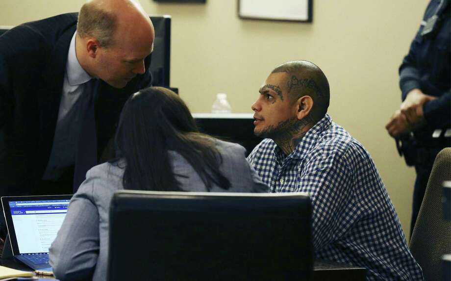 Gabriel Moreno (right) talks with his attorney Albert Gutierrez, Jr. (left) as jurors proceed with another day of deliberations for his murder trial on Thursday, Mar. 8, 2018. Jurors continued deliberations on Thursday on whether to convict Moreno, a San Antonio man, of murder in a 2014 baseball bat-beating of Jose Luis Menchaca who was later suffocated, dismembered and his remains grilled on a barbecue pit. (Kin Man Hui/San Antonio Express-News) Photo: Kin Man Hui, Staff / San Antonio Express-News / ©2018 San Antonio Express-News