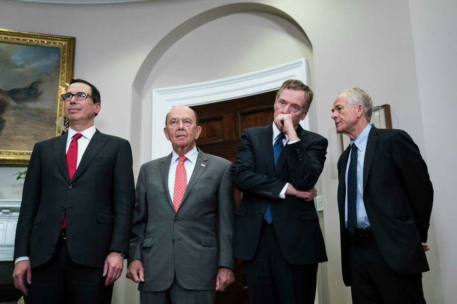 Treasury Secretary Steven Mnuchin, Commerce Secretary Wilbur Ross, U.S. Trade Representative Robert Lighthizer, and Peter Navarro of the White House National Trade Council attend the ceremony. Navarro was one of the administration's biggest supporters of Trump's plan to set the tariffs. Must credit: Washington Post photo by Jabin Botsford Photo: Jabin Botsford, The Washington Post / The Washington Post