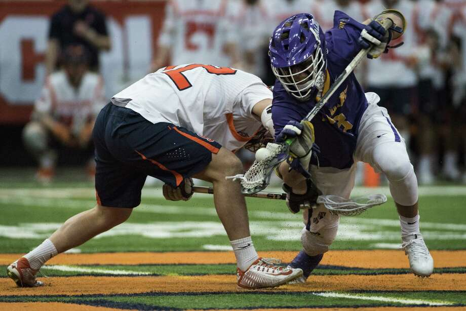 UAlbany's TD Ierlan wins a faceoff against Syracuse during the Danes' 15-3 win on Saturday, Feb. 17, 2018, at the Carrier Dome in Syracuse. (Bryan Cereijo / Syracuse.com) Photo: Bryan Cereijo / SYR
