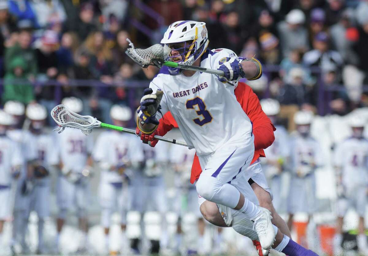 TD Ierlan of Albany runs up the field after winning a face-off against a Cornell player during their game on Sunday, March 4, 2018, in Albany, N.Y. (Paul Buckowski/Times Union)