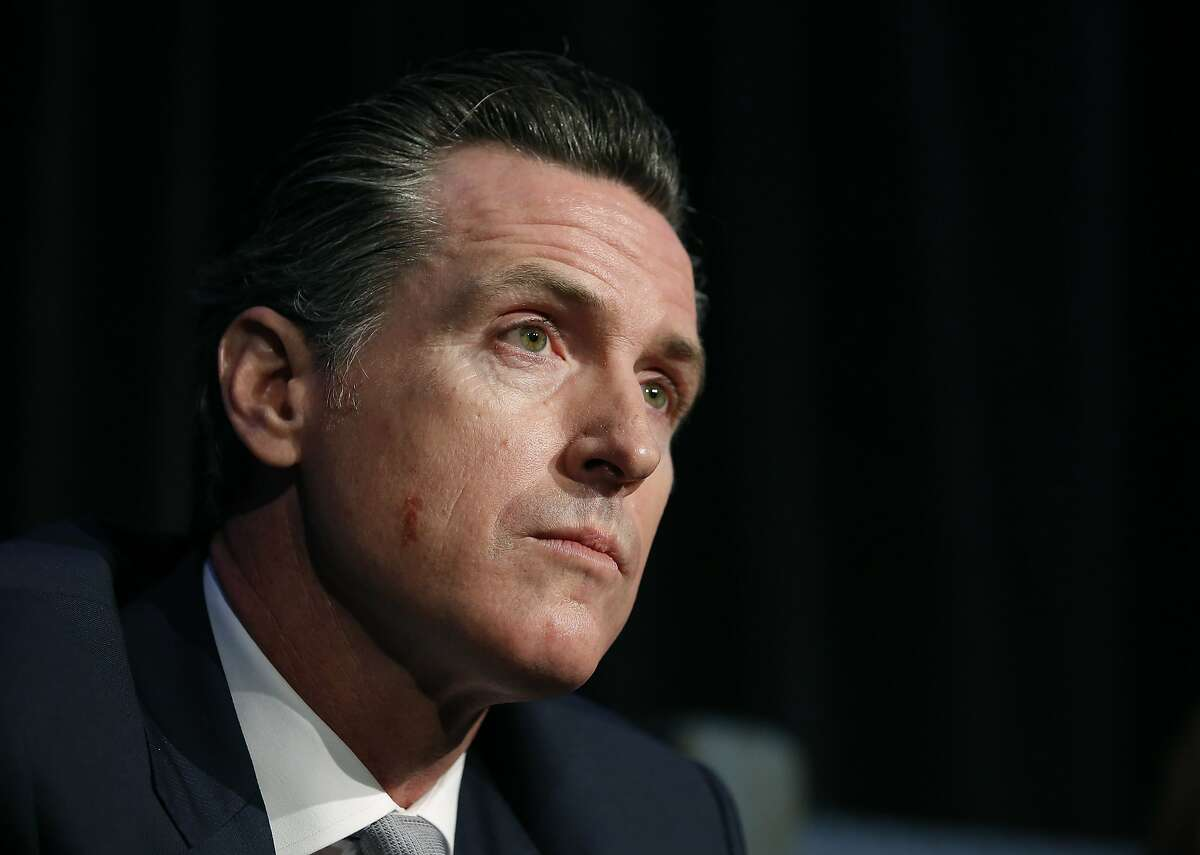 Lt. Gov. Gavin Newsom, a candidate for California governor, listens to a question during a gubernatorial candidates forum, Tuesday, April 4, 2017, in Sacramento, Calif. Newsom along with fellow Democratic gubernatorial candidates, state Treasurer John Chiang and former Los Angeles Mayor Antonio Villaraigosa addressed attendees at a conference held by Crime Survivors For Safety and Justice. (AP Photo/Rich Pedroncelli)