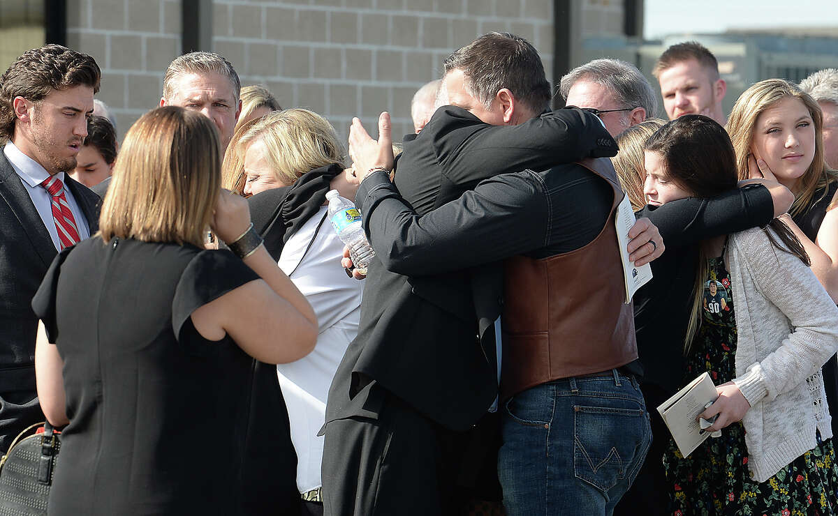 Family, friends and Rice University football teammates console one another following the procession outside of Wesley United Methodist Church Thursday for the funeral services honoring Blain Padgett. The Hardin - Jefferson graduate and Rice football player was found dead at his home after missing a practice last week. The cause of death remains unknown. Photo taken Thursday, March 8, 2018 Kim Brent/The Enterprise