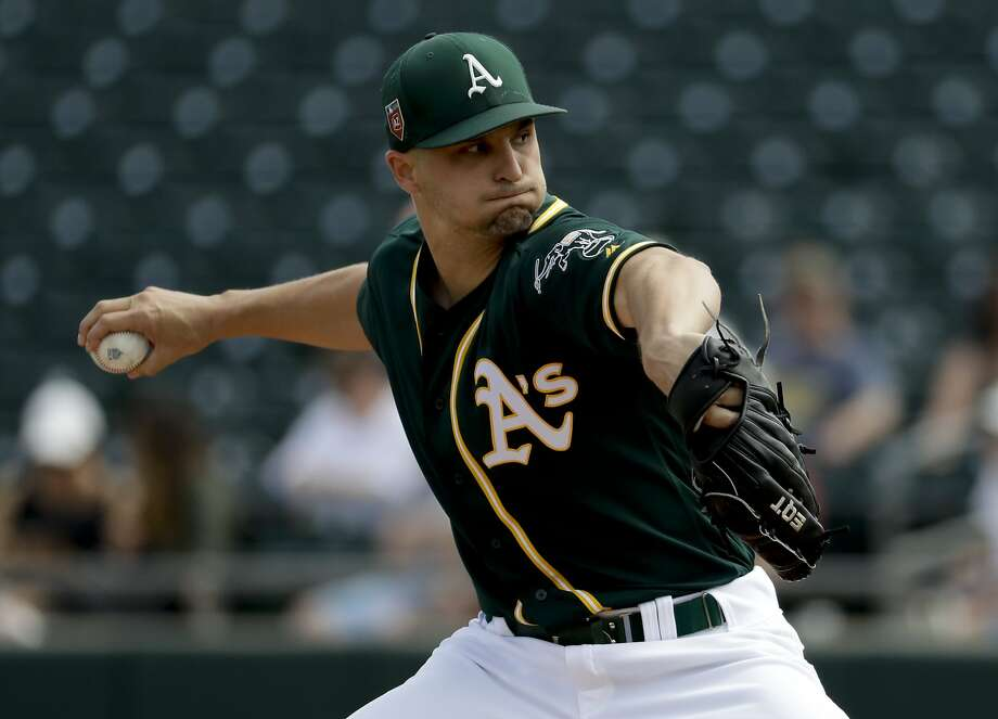 Oakland Athletics starting pitcher Kendall Graveman throws against the Los Angeles Angels during the first inning of a spring baseball game in Mesa, Ariz., Thursday, March 8, 2018. (AP Photo/Chris Carlson) Photo: Chris Carlson, Associated Press