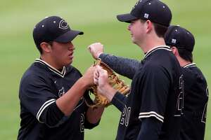 Conroe relief pitcher Jose Quiroga (21) gets fist-bumps from teammates after getting Kolby Kubichek #2 of Bryan to fly out to right field and end the sixth inning of a game during the Klein Tomball Tournament, Thursday, March 8, 2018, in Tomball.