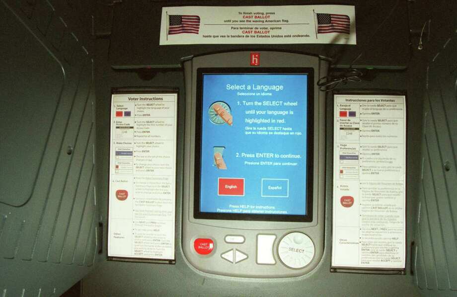 The Harris County Clerk's Office estimates that replacing the county's 8,189 eSlate machines would cost about $75 million. Photo: John Everett, Staff / Houston Chronicle / Houston Chronicle