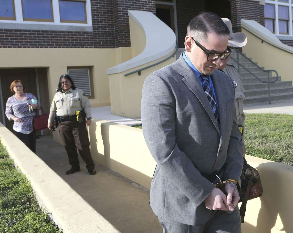 Murder defendant Shaun Puente (right, foreground) leaves court Thursday in Jourdanton. On Friday, he was sentenced to life in prison without parole Friday for killing San Antonio Police Department officer Robert Deckard in 2013.