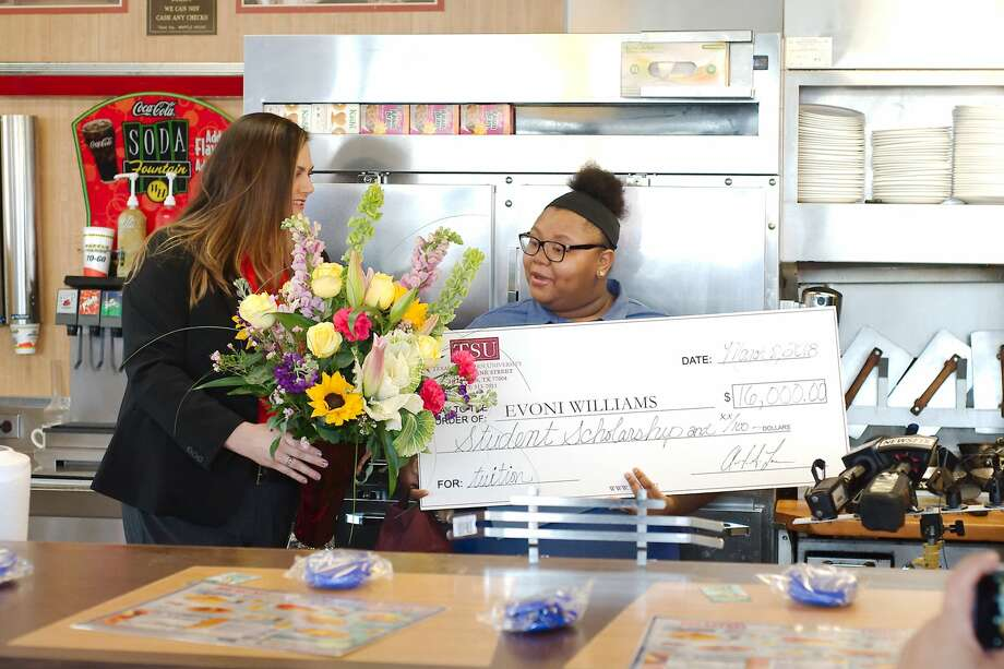 Evoni Williams reacts as La Marque Economic Development Corporation Public Relations Specialist Colleen Merit presents her with flowers in recognition for her kindness and service to the community of La Marque Thursday, Mar. 8. Photo: Kirk Sides / Houston Chronicle