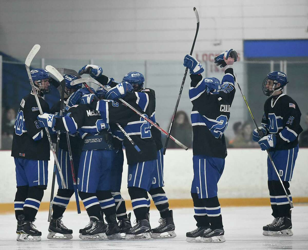 Darien celebrates following their 3-2 overtime win against Notre Dame-West Haven, Thursday, March 8, 2018, in the Division 1 first-round game at Bennett Rink in West Haven.