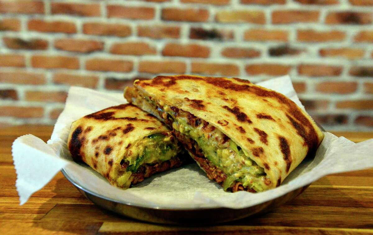 A Chili Brown Sugar Brisket Southwestern: corn & avocado salsa, jalapenoes, chipotle remoulade, pepperjack cheese, bacon Flat Bread Roasted Sandwich, one of many sandwich combo that can be ordered, at the new Roasted Sandwich Company store on Bedford Street in Stamford, Conn.