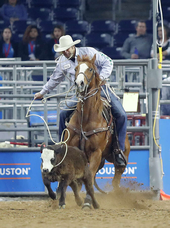 Adam Gray ropes a steer in the tie-down competition during the Super Series IV, round 1 at the Houston Livestock Show and Rodeo at NRG Stadium, Thursday, March 8, 2018, in Houston.  ( Karen Warren / Houston Chronicle ) Photo: Karen Warren/Houston Chronicle
