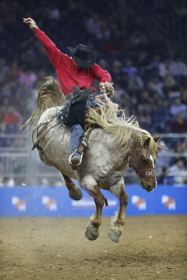 Jade Blackwell rides Redon Acres in the Saddle Bronc Riding competition during the Super Series IV, round 1 at the Houston Livestock Show and Rodeo at NRG Stadium, Thursday, March 8, 2018, in Houston.  ( Karen Warren / Houston Chronicle ) Photo: Karen Warren/Houston Chronicle