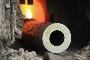 A 120 mm smoothbore gun barrel used on an Abrams tank is slowly inserted into a heat treatment unit before being machined Tuesday, Aug. 19, 2014, at the Watervliet Arsenal in Watervliet, N.Y. The barrels are annealed through a multi-stage heating and cooling process. (Will Waldron/Times Union)