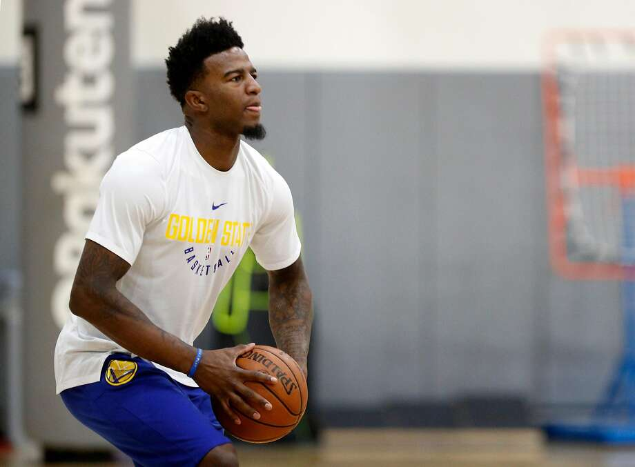Jordan Bell fires a long shot during a Golden State Warriors' practice, on Thurs. March 8, 2018, in Oakland, Calif. Photo: Michael Macor, The Chronicle