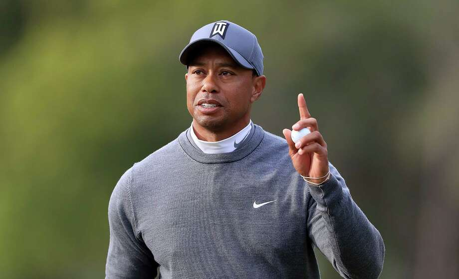 PALM HARBOR, FL - MARCH 08:  Tiger Woods acknowledges the crowd on the 16th hole during the first round of the Valspar Championship at Innisbrook Resort Copperhead course on March 8, 2018 in Palm Harbor, Florida.  (Photo by Sam Greenwood/Getty Images) Photo: Sam Greenwood / 2018 Getty Images