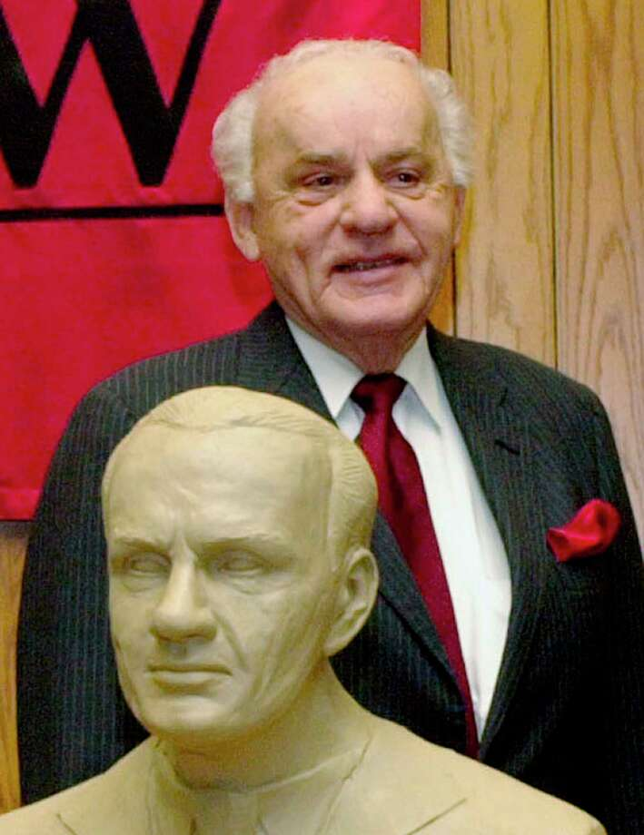 FILE - In this Feb. 22, 2003 file photo, former Neb. Governor, Charles Thone stands behind his clay bust in Lincoln, Neb., as the University of Nebraska-Lincoln College of Law paid tribute to five alumni governors. Thone, a former Nebraska governor and congressman who helped investigate the assassinations of President John F. Kennedy and Martin Luther King Jr., has died. He was 94. Thone's law partner and longtime friend, Mark Schorr, said Thone died Wednesday, March 7, 2018, of natural causes at his home in Lincoln. (AP Photo/Nati Harnik File) Photo: Nati Harnik / Copyright 2018 The Associated Press. All rights reserved.