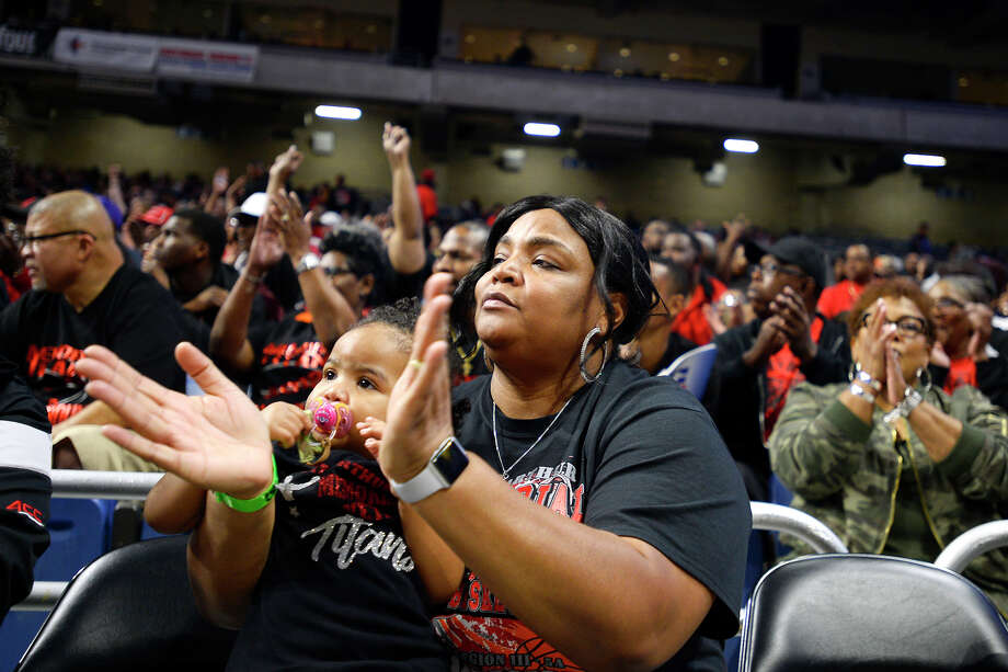 Nadria Turner, cheer sponsor for Memorial, and her granddaughter, Rose Nabors, cheer for the Titans as they play against Midlothian in the class 5A state semifinals at the Alamodome in San Antonio on Thursday evening.  Photo taken Thursday 3/8/18 Ryan Pelham/The Enterprise Photo: Ryan Pelham / ©2017 The Beaumont Enterprise/Ryan Pelham