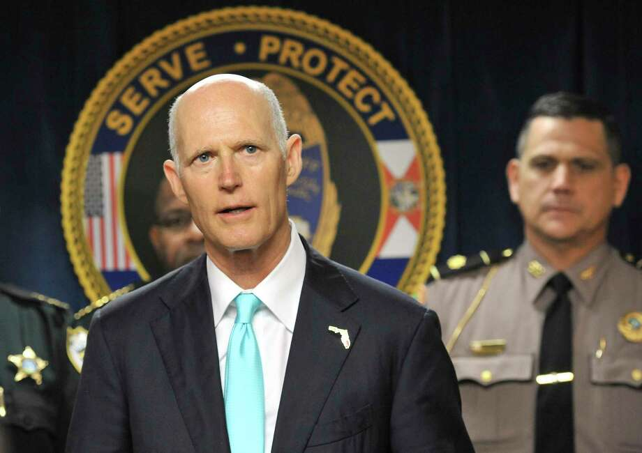 Flanked by area law enforcement and city leaders Florida Governor Rick Scott made a stop at the Jacksonville Sheriff's Office to talk about his plan to spend $500 million dollars to increase school safety in the state Wednesday, Feb. 28, 2018. (Bob Self/The Florida Times-Union via AP) Photo: Bob Self / Copyright The Florida Times-Union 2018