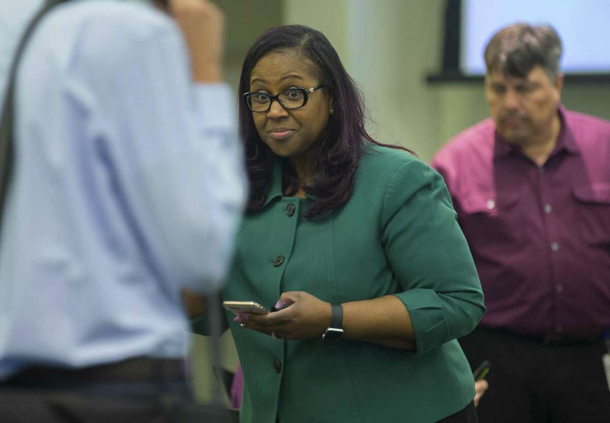 Grenita Lathan, the chief academic officer at Houston Independent School District, talks to attendees before an HISD school board meeting, Thursday, March 8, 2018, in Houston. ( Mark Mulligan / Houston Chronicle )