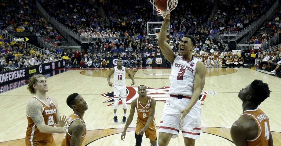 Texas Tech's Zhaire Smith dunks the ball during the second half of an NCAA college basketball game against Texas in the Big 12 men's tournament Thursday, March 8, 2018, in Kansas City, Mo. (AP Photo/Charlie Riedel) Photo: Charlie Riedel/Associated Press