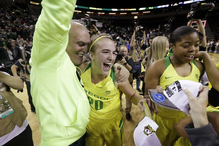 Oregon's Sabrina Ionescu (20) celebrates with her dad, Dan Ionescu, after the team beat Stanford in an NCAA college basketball game in the finals of the Pac-12 Conference women's tournament, Sunday, March 4, 2018, in Seattle. Oregon won 77-57. (AP Photo/Elaine Thompson) Photo: Elaine Thompson, Associated Press