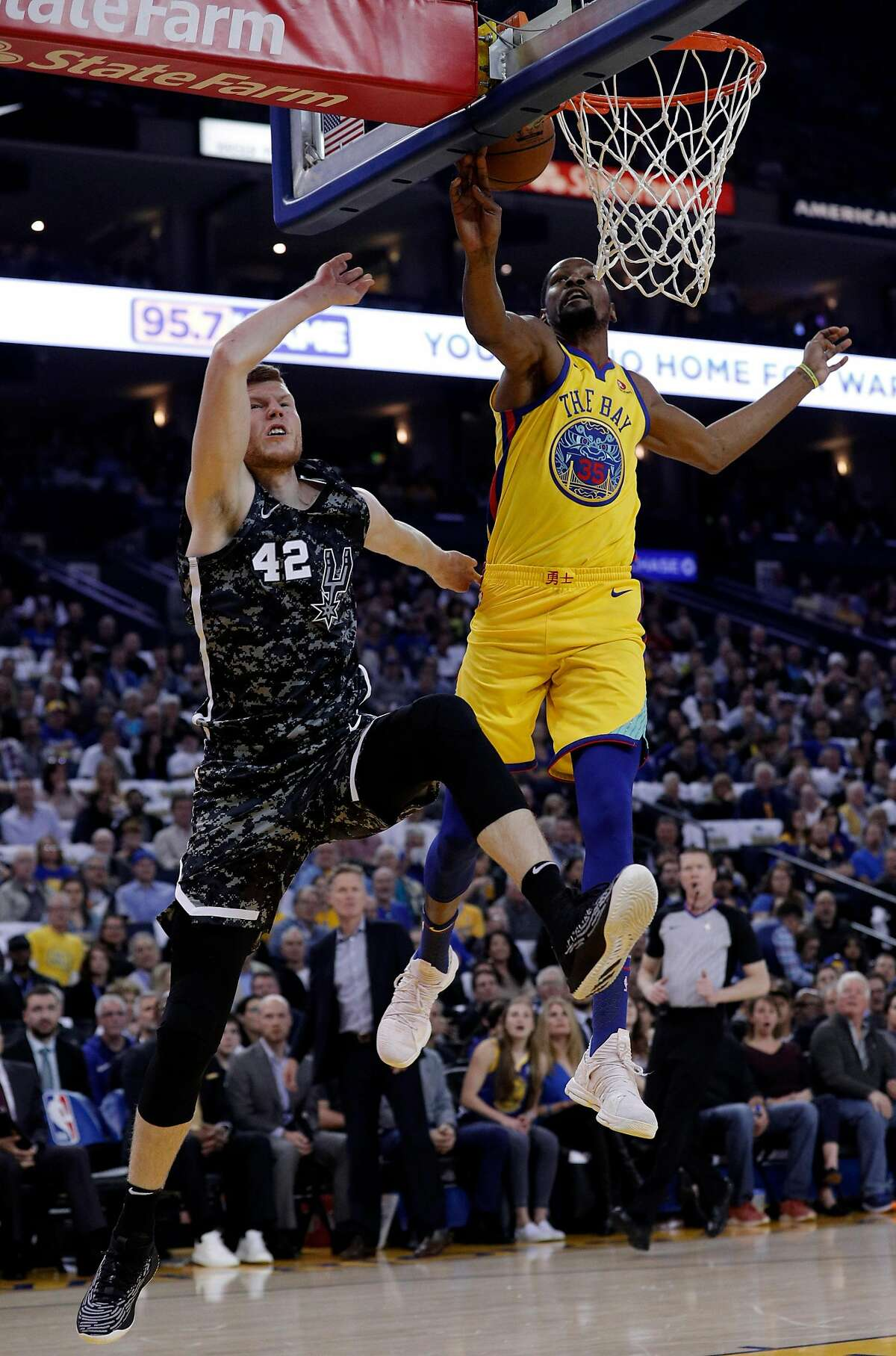 Kevin Duran (35) blocks a shot by Davis Bertans (42) in the first half as the Golden State Warriors played the San Antonio Spurs at Oracle Arena in Oakland, Calif., on Thursday, March 8, 2018.