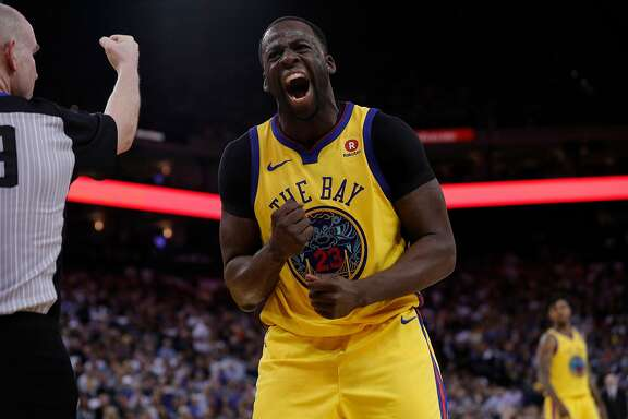 Draymond Green (23) reacts after getting a foul call in the first half as the Golden State Warriors played the San Antonio Spurs at Oracle Arena in Oakland, Calif., on Thursday, March 8, 2018.