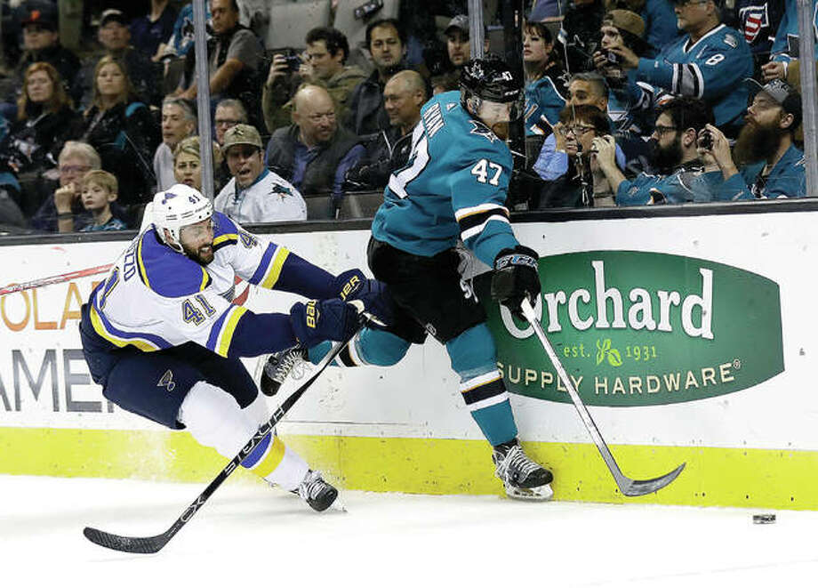 Joakim Ryan of the Sharks (47) is defended by the Blues' Robert Bortuzzo (41) Thursday night in San Jose, Calif. Photo: Associated Press