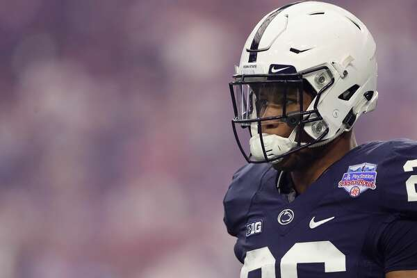 GLENDALE, AZ - DECEMBER 30:  Running back Saquon Barkley #26 of the Penn State Nittany Lions walks on the field during the first half of the Playstation Fiesta Bowl against the Washington Huskies at University of Phoenix Stadium on December 30, 2017 in Glendale, Arizona.  (Photo by Christian Petersen/Getty Images)
