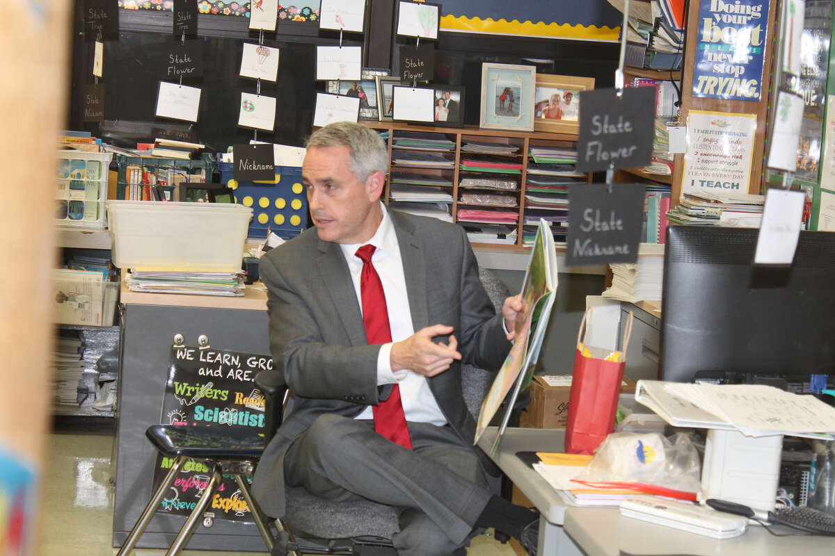 """Madison County State's Attorney Tom Gibbons reads """"Wordy Birdy"""" during the Read Across America event Thursday at Woodland Elementary School."""