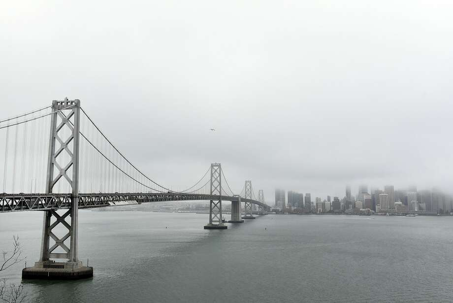FILE -- Fog and clouds hang over San Francisco, CA, on Thursday August 24, 2017. Photo: Michael Short, Special To The Chronicle