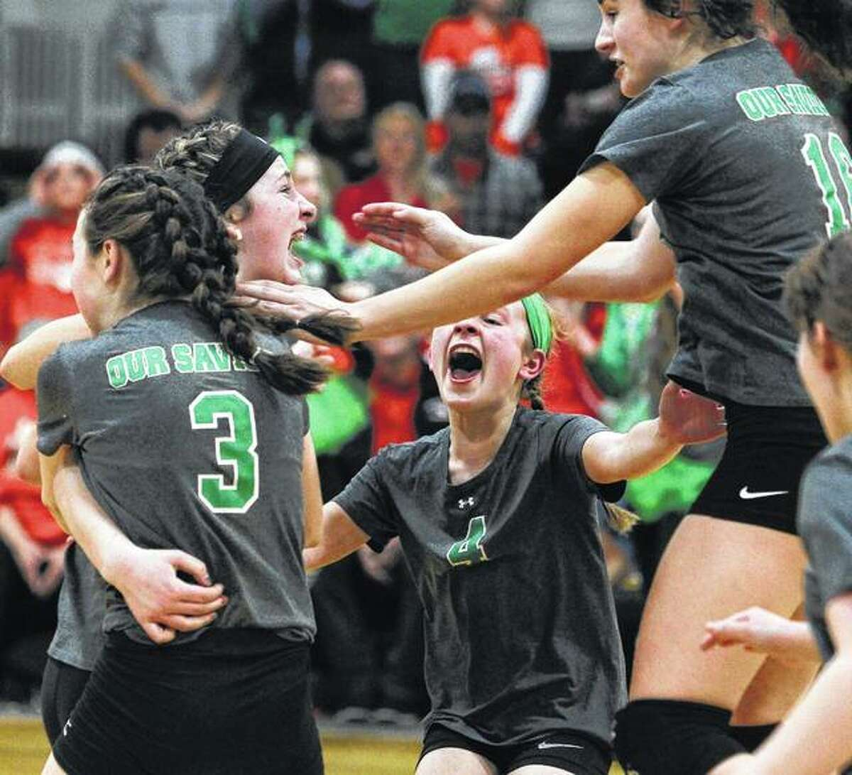 Members of the Our Saviour eighth-grade volleyball team celebrate their win over Waverly in the Our Saviour Regional championship game. After losing the first set, the Shamrocks rallied for a 21-25, 25-19, 25-23 victory.