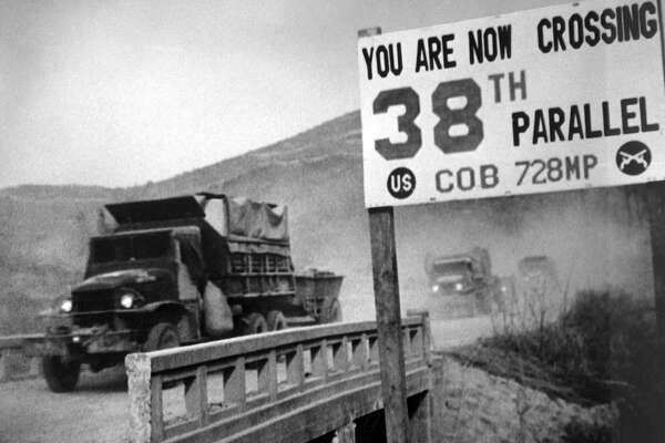 View of United Nations forces, traveling in trucks, crossing the 38th parallel as they withdraw from Pyongyang, the North Korean capital, 1950. (Photo by Interim Archives/Getty Images)