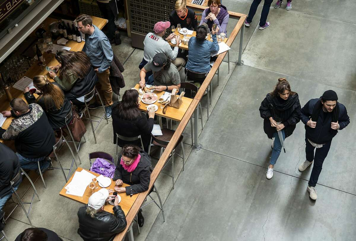People dine at Ferry Plaza Wine Bar inside the Ferry Building Saturday, March 3, 2018 in San Francisco, Calif.
