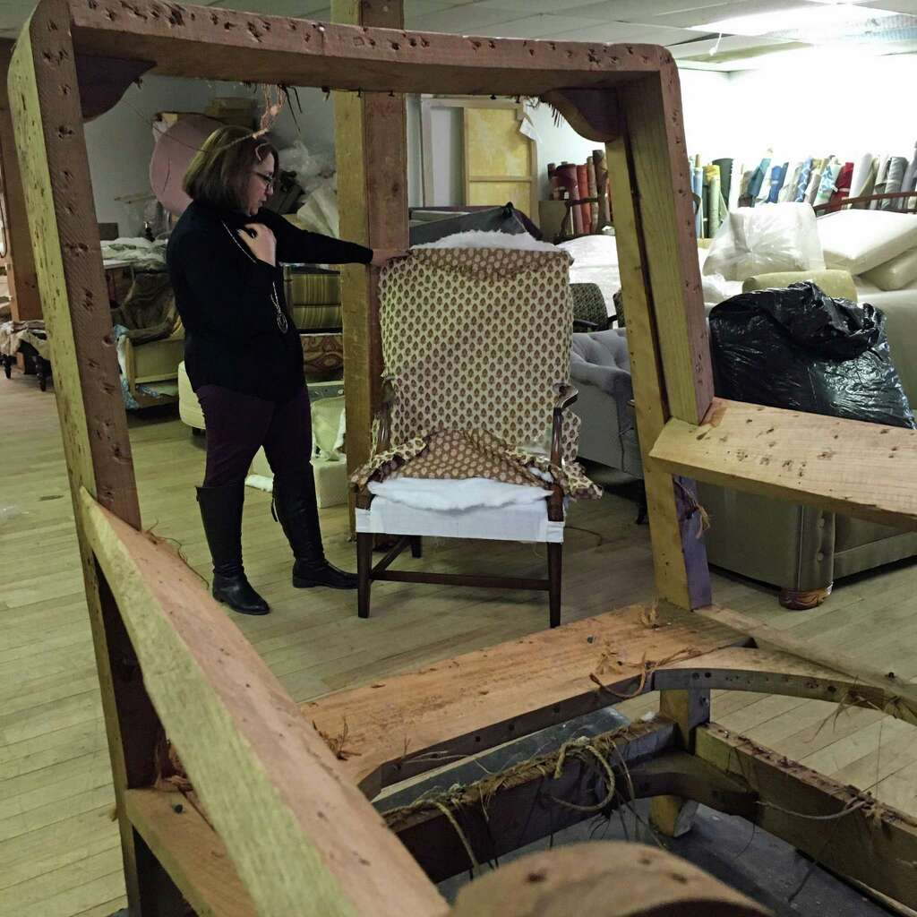 Bethel Upholstery Owner Ana Matias Stands In Her Workshop. As One Frame  Stands Ready To