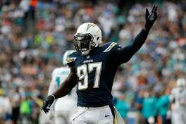 SAN DIEGO, CA - DECEMBER 20: Jeremiah Attaochu #97 of the San Diego Chargers motions during a game against the Miami Dolphins at Qualcomm Stadium on December 20, 2015 in San Diego, California. (Photo by Sean M. Haffey/Getty Images)