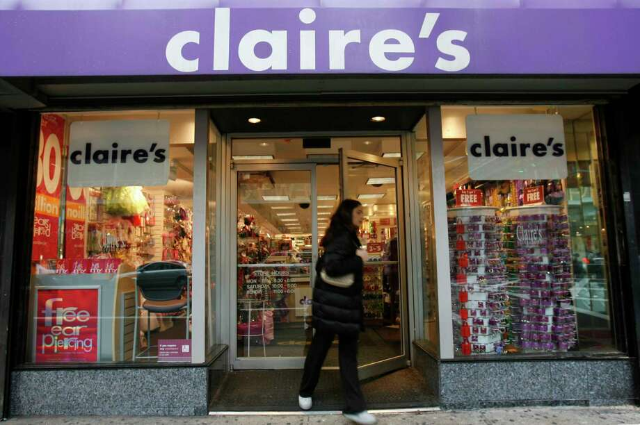A woman exits a Claire's store on Dec. 1, 2006, in New York. Photo: Daniel Acker/Bloomberg / Bloomberg