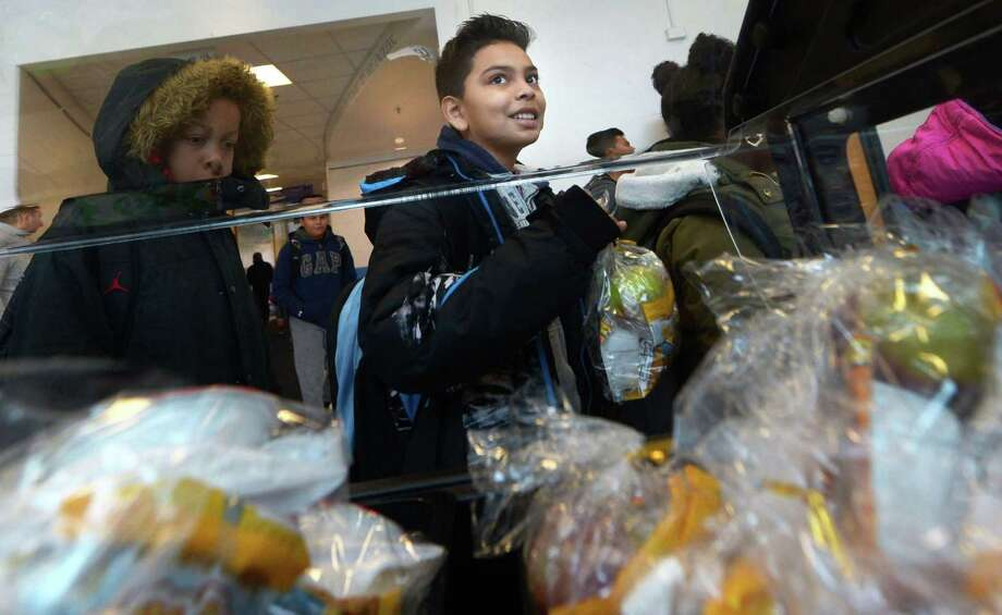 "Students at Kendall Elementary School including fifth-grader Gabriel Ochoa take advantage of the school's ""Grab and Go"" breakfast program. Photo: Erik Trautmann / Hearst Connecticut Media / Norwalk Hour"