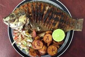 Poisson braise, a whole fried tilapia, from Kaedi Dimbe African Cuisine.