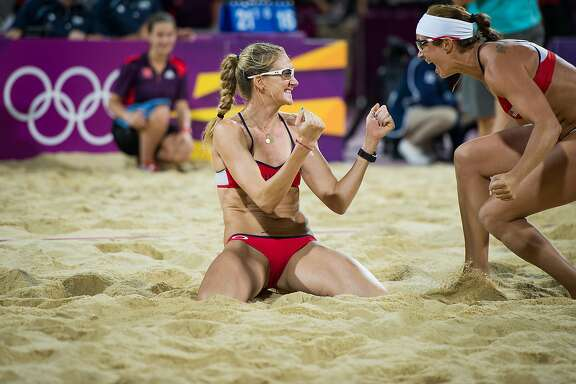 Kerri Walsh Jennings, left, and Misty May-Treanor celebrate after defeating Jennifer Kessy and April Ross in the women's beach volleyball gold medal match at the 2012 London Olympics on Wednesday, Aug. 8, 2012.( Smiley N. Pool / Houston Chronicle )