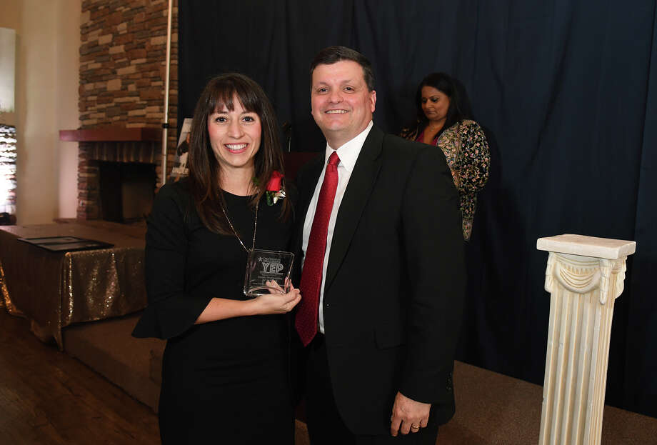 Dr. Elizabeth Fagen, left, of Humble ISD, is all smiles after receiving her award as the Young Professional of the Year from Noel Cardenas, right, Chief Operating Officer with Memorial Hermann Northeast, during the Lake Houston Area Chamber of Commerce YEP Awards event at The Overlook in Atascocita on March 8, 2018. (Photo by Jerry Baker/Freelance) Photo: Jerry Baker, Freelance / Freelance