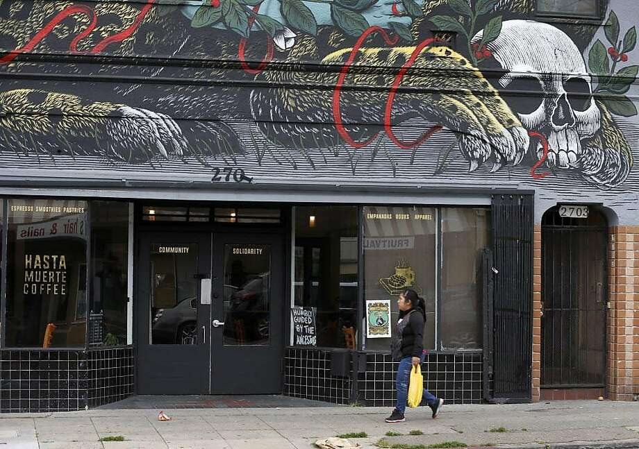 A large mural is painted above Hasta Muerte Coffee in Oakland on Friday, March 9, 2018. Owners of the cafe on Fruitvale Avenue are refusing service to uniformed police officers. Photo: Paul Chinn, The Chronicle