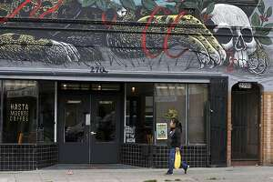 A large mural is painted above Hasta Muerte Coffee in Oakland, Calif. on Friday, March 9, 2018. Owners of the cafe on Fruitvale Avenue are refusing service to uniformed police officers.