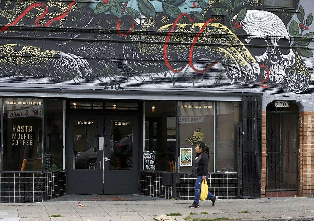 A large mural is painted above Hasta Muerte Coffee in Oakland on Friday, March 9, 2018. Owners of the cafe on Fruitvale Avenue are refusing service to uniformed police officers.