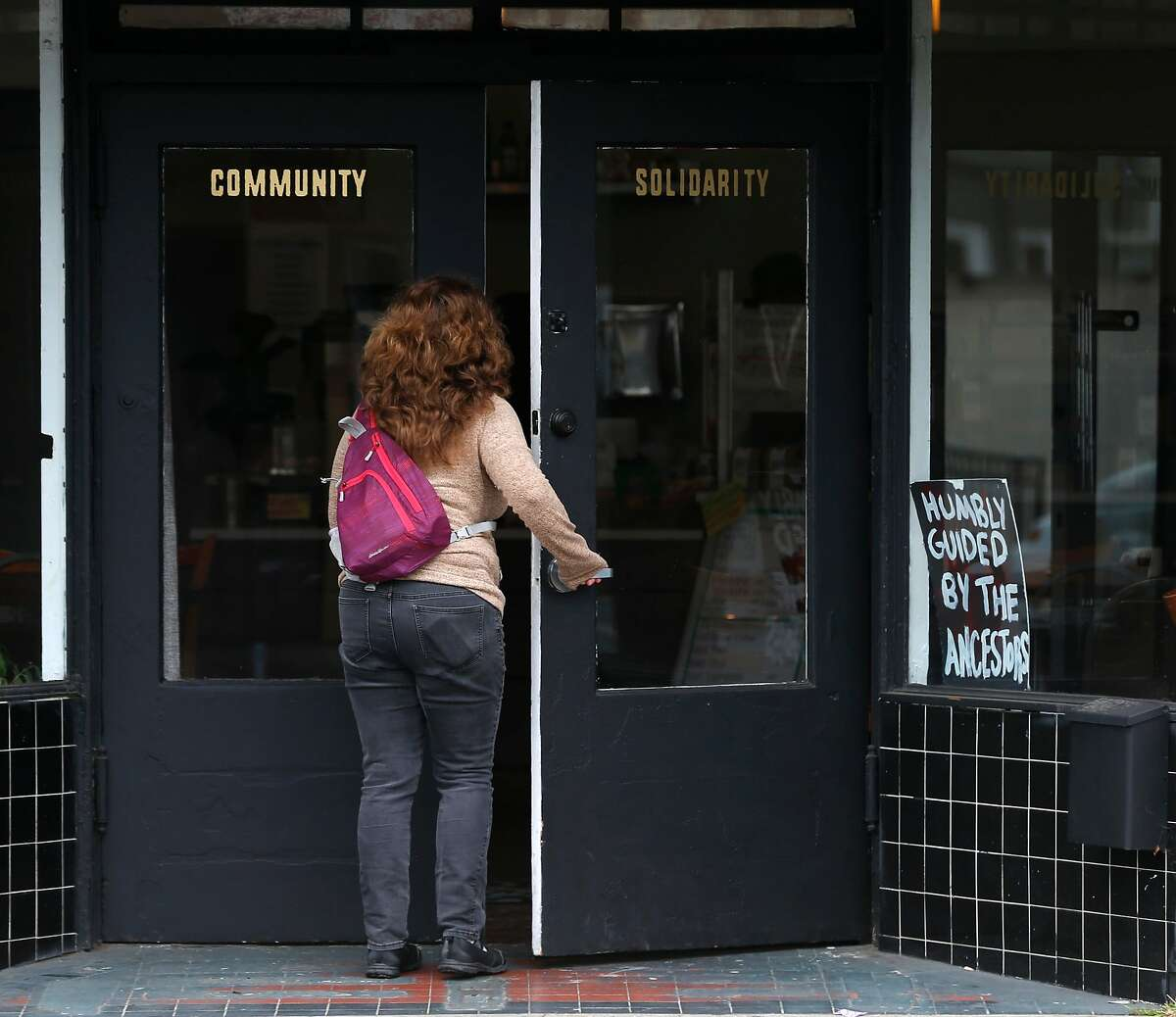 A customer enters Hasta Muerte Coffee in Oakland on Friday, March 9, 2018. Owners of the cafe on Fruitvale Avenue are refusing service to uniformed police officers.