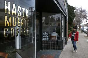 A customer arrives at Hasta Muerte Coffee in Oakland, Calif. on Friday, March 9, 2018. Owners of the cafe on Fruitvale Avenue are refusing service to uniformed police officers.